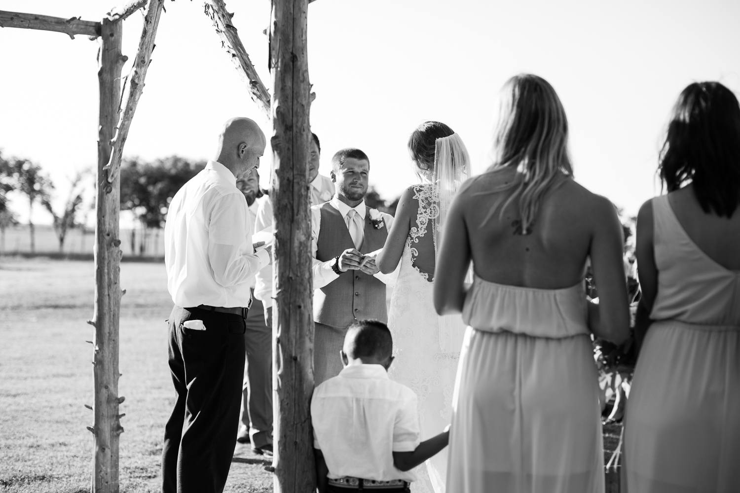 While Jordan stood in the center aisle, I ducked behind the bridesmaids to focus on the groom's face as he said his vows.