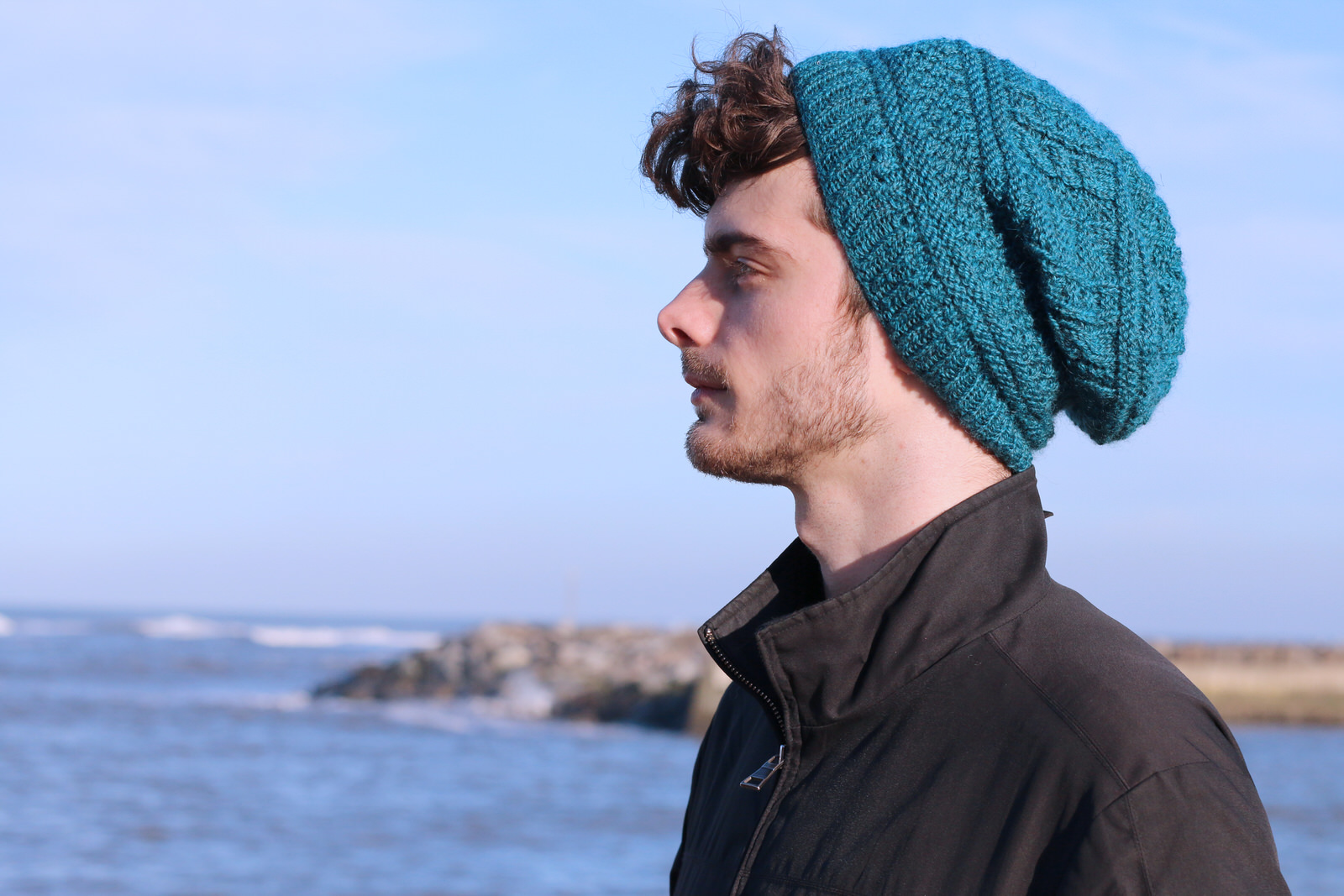 """Ravenscar hat  A sampler hat using a combination of classic gansey motifs  Yarn: Dovestone DK (252 yds / 230m in 100g)  Yarn Quantities: 252 yards (230 m)  Needles:  3.5mm x 40cm circular, 4mm x 40cm circular and DPNs  Notions:  6 stitch markers, cable needle  Sizes: To fit head: 46 (51, 56)cm/18 (20, 22)"""""""