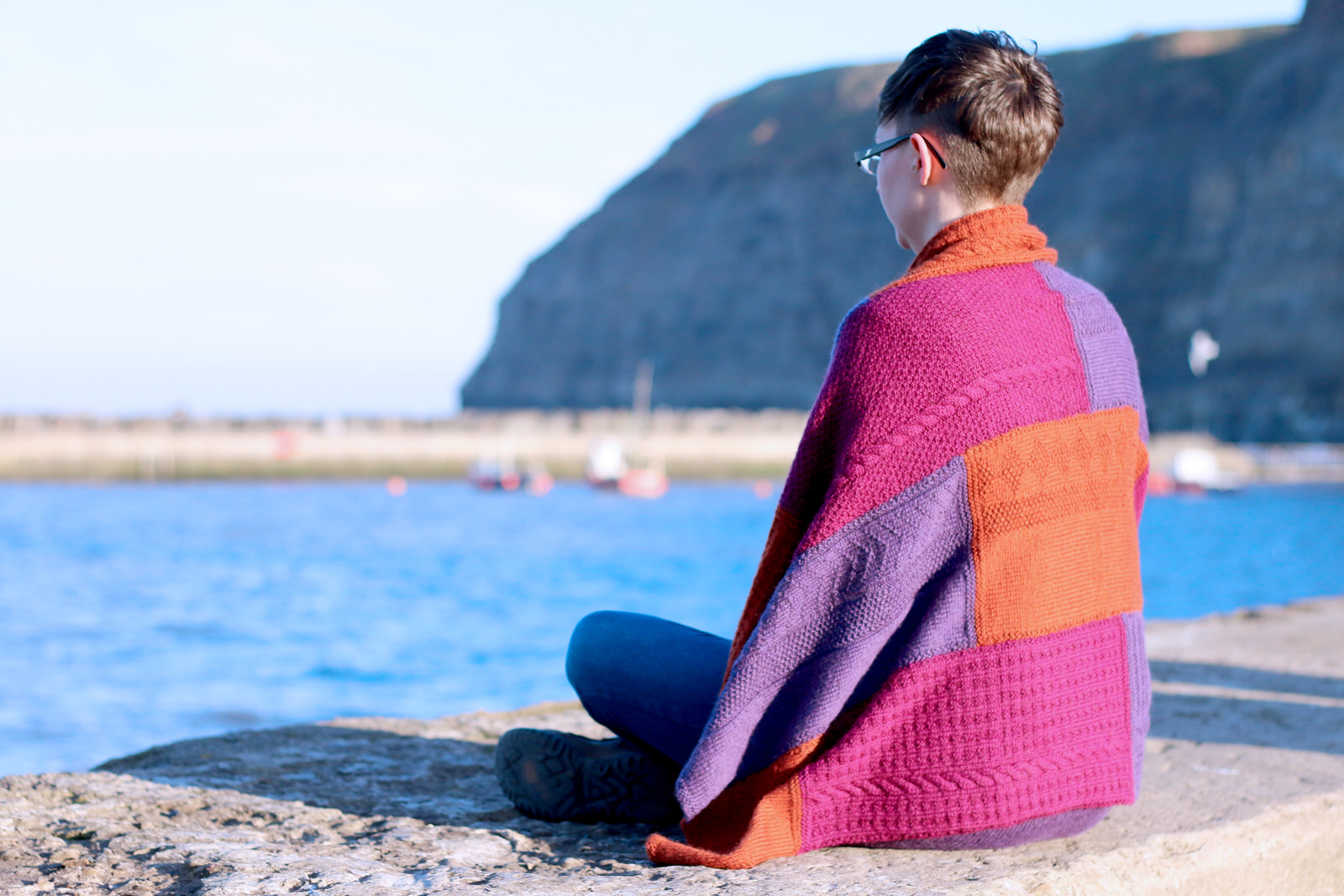 """Sandsend blanket  A blanket with a patchwork sampler effect, using a variety of stitch patterns found throughout the Yorkshire Shores book  Yarn: Yarn:Dovestone DK (252 yds / 230m in 100g)  Yarn Quantities: 1509 yards (1380 m)  Needles:  4mm  Notions:  Cable needle  Size:  88 x 132cm / 34.5 x 52"""""""