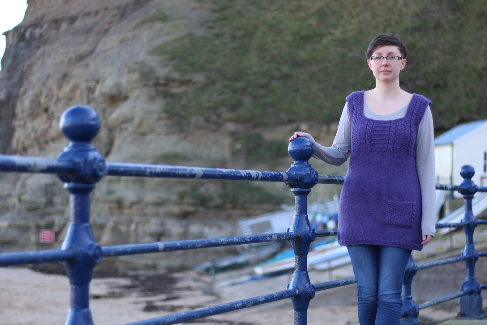 Withernsea Tunic  A tunic with cable straps and pocket detail, sized for adults (above) and children (right)   Yarn: Dovestone DK (252 yds / 230m in 100g)  Yarn Quantities: 1006 - 1761 yards (920 - 1610 m)   Needles:  3.75mm x 60-80cm circular and 4.0mm 60-80cm circular  Notions: cable needle, stitch markers