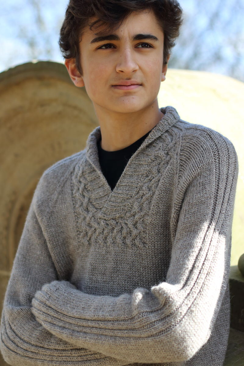 """Terry's Pullover by Carol Feller  The body of this sweater is knitted from the bottom up in one piece. Sleeves are knitted flat to make joining the yoke in the round easier.   Yarn: Baa Ram Ewe's Dovestone Natural Aran (170m in 100g)  Yarn Quantities:  1000 - 1540 yards (914 - 1408 m)   Needles: 4.5 mm x 80cm circular and straight, 4mm x 80cm circular and straight  Notions:  cable needle, stitch holders  Finished Size:  37 (41¼, 44¾, 48¾, 53)"""" chest circumference."""