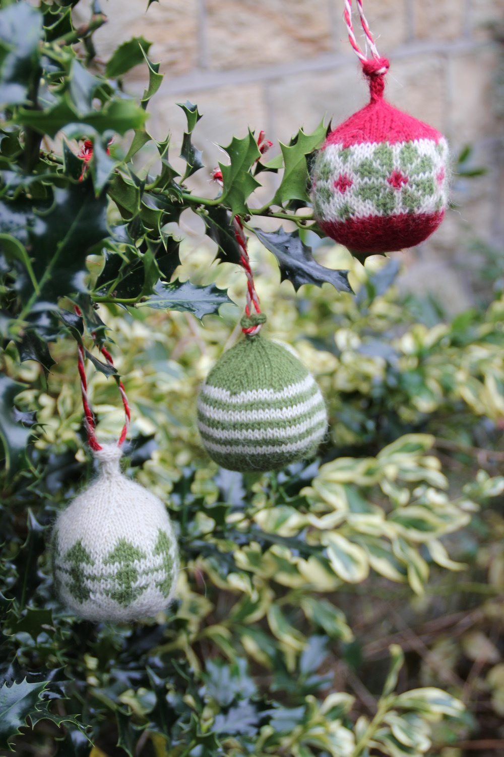 Dingle Baubles by Jo Spreckley  Yarn: Baa Ram Ewe Titus (70% Wool, 30% Alpaca) 320m per 100g hank Kit includes: - Pattern leaflet - Mini hanks of Titus in colours Chevin, White Rose and Wesley Bob - Toy stuffing - Tapestry needle for sewing up You will also need: - 2.25 or 2.5mm DPNs