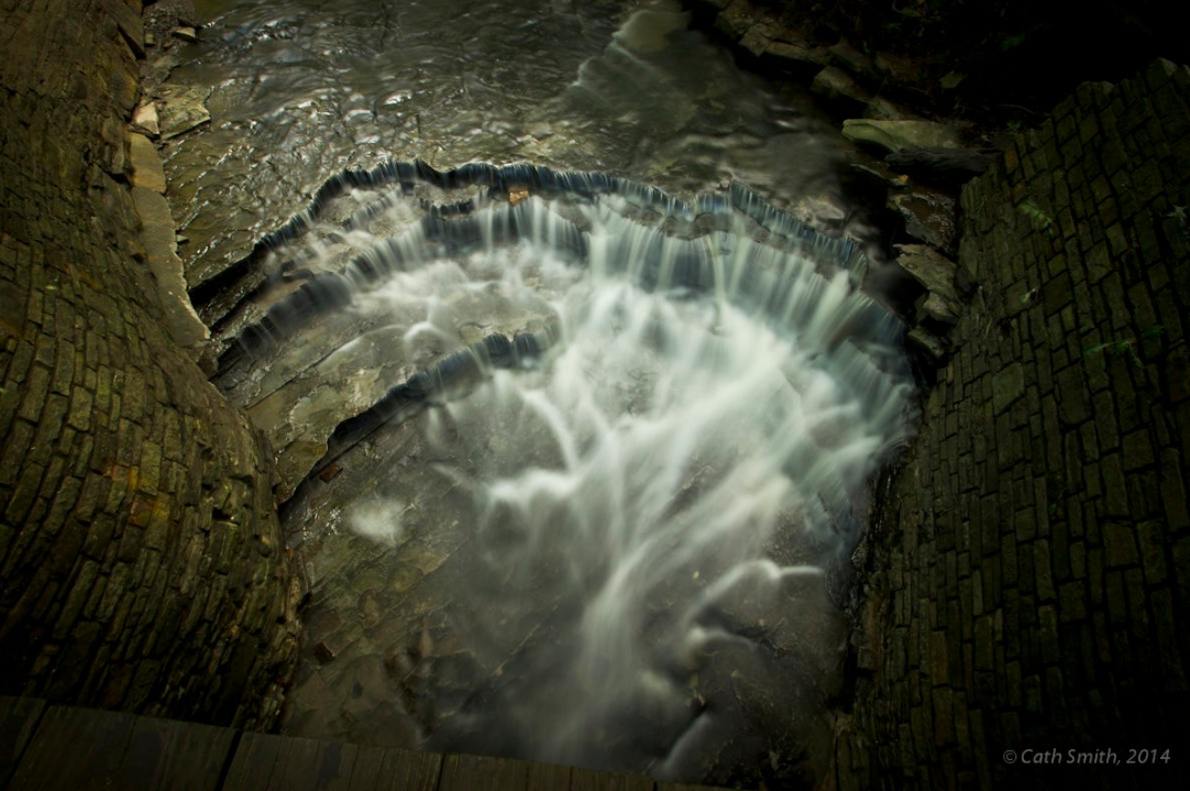 A long shutter speed helps blur the water and capture enough detail in this dark scene.