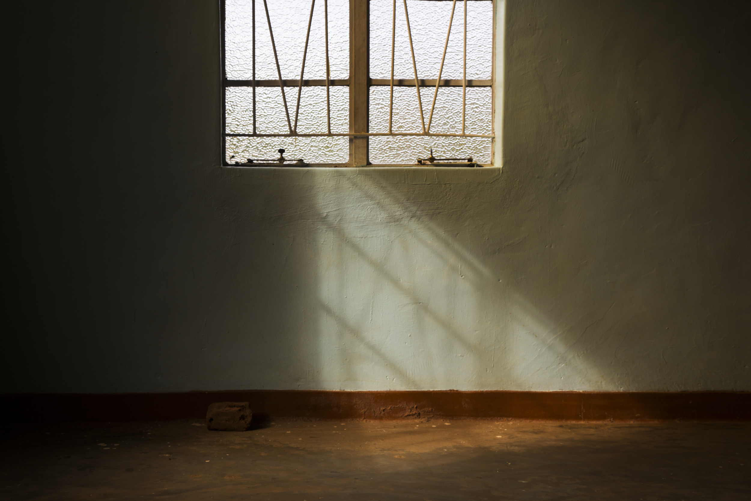 Morning light shines in through the window as members arrive at a Pentecostal church in Ntcheu District of Malawi, Africa on March 8, 2015.