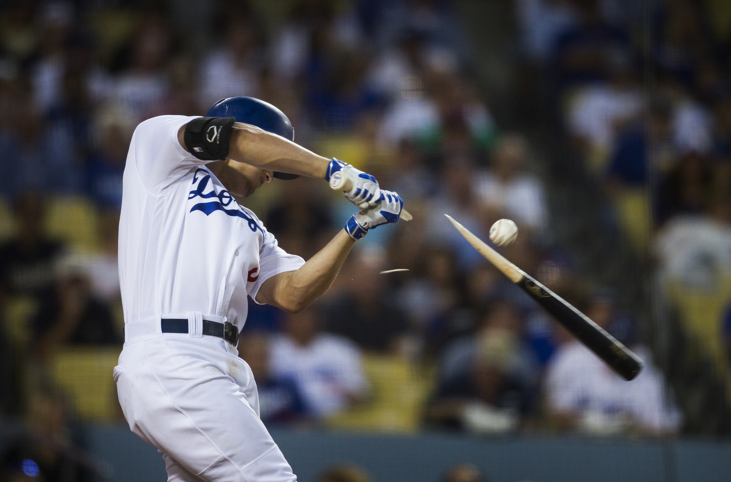 Los Angeles Dodgers Corey Seager breaks his bat in the third inning while batting against the Arizona Diamondbacks on Friday, July 29, 2016.