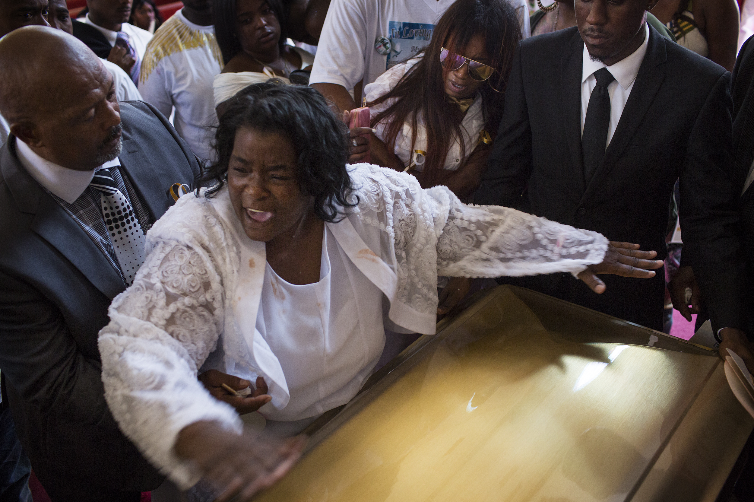 "Barbara Pritchett-Hughes yells, ""Its done. It's over,"" as she slams her son, DeAndre Hughes, casket shut at his funeral on Friday, July 29, 2016, after he was fatally shot a week earlier in Compton, CA. Barbara said her mind instantly flashed back to nine years earlier when her 15-year-old son, Dovon Harris, was fatally shot in Watts. As the homicide rate in Los Angeles county continues to plummet, the threat of being shot to death still remains a daily threat."