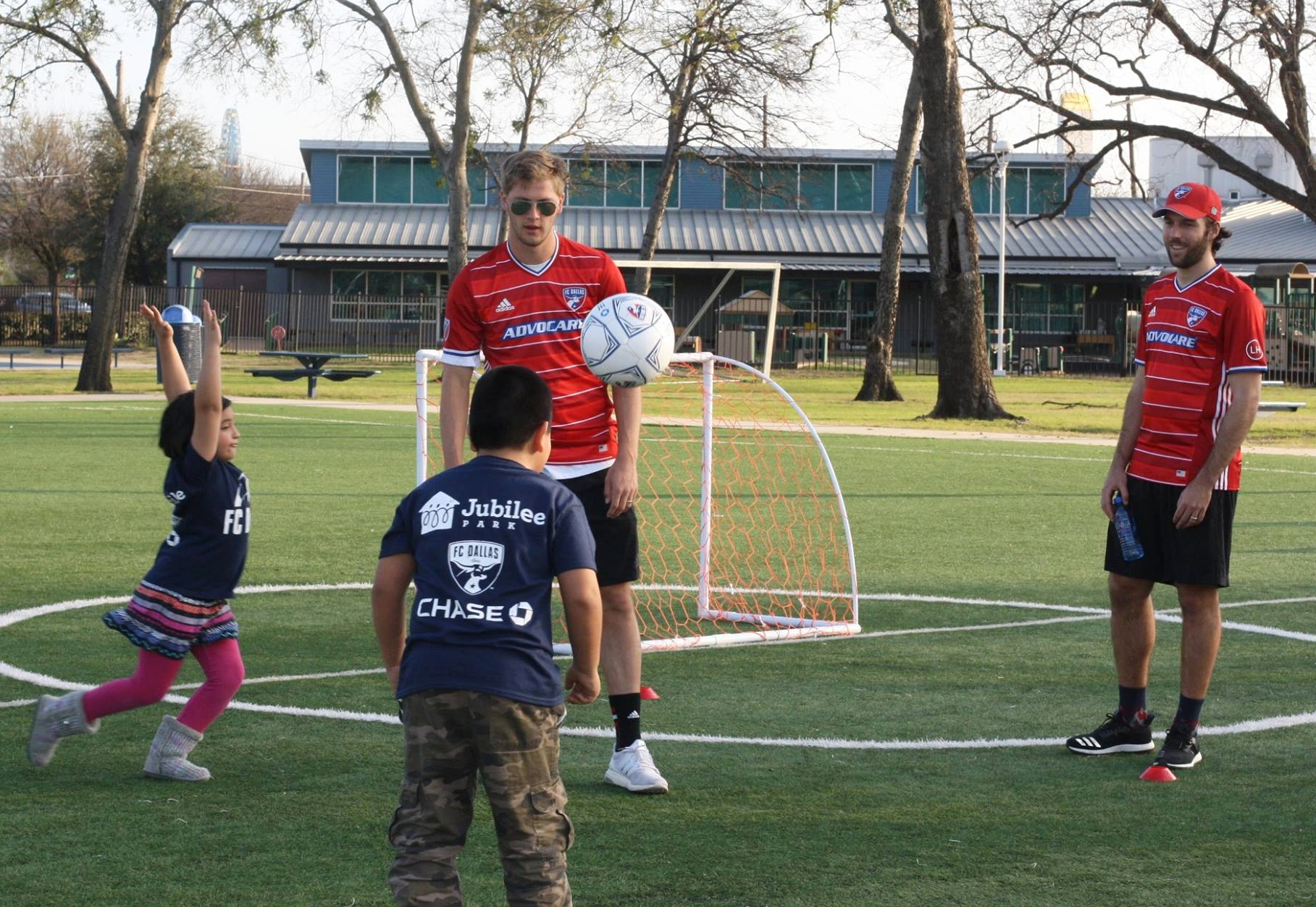 FC Dallas players Walker Zimmerman, Victor Ulloa, Ryan Hollingshead and Kellyn Acosta played soccer with 200 Jubilee students, unveiling thousands of dollars' worth of gear donated by Chase.