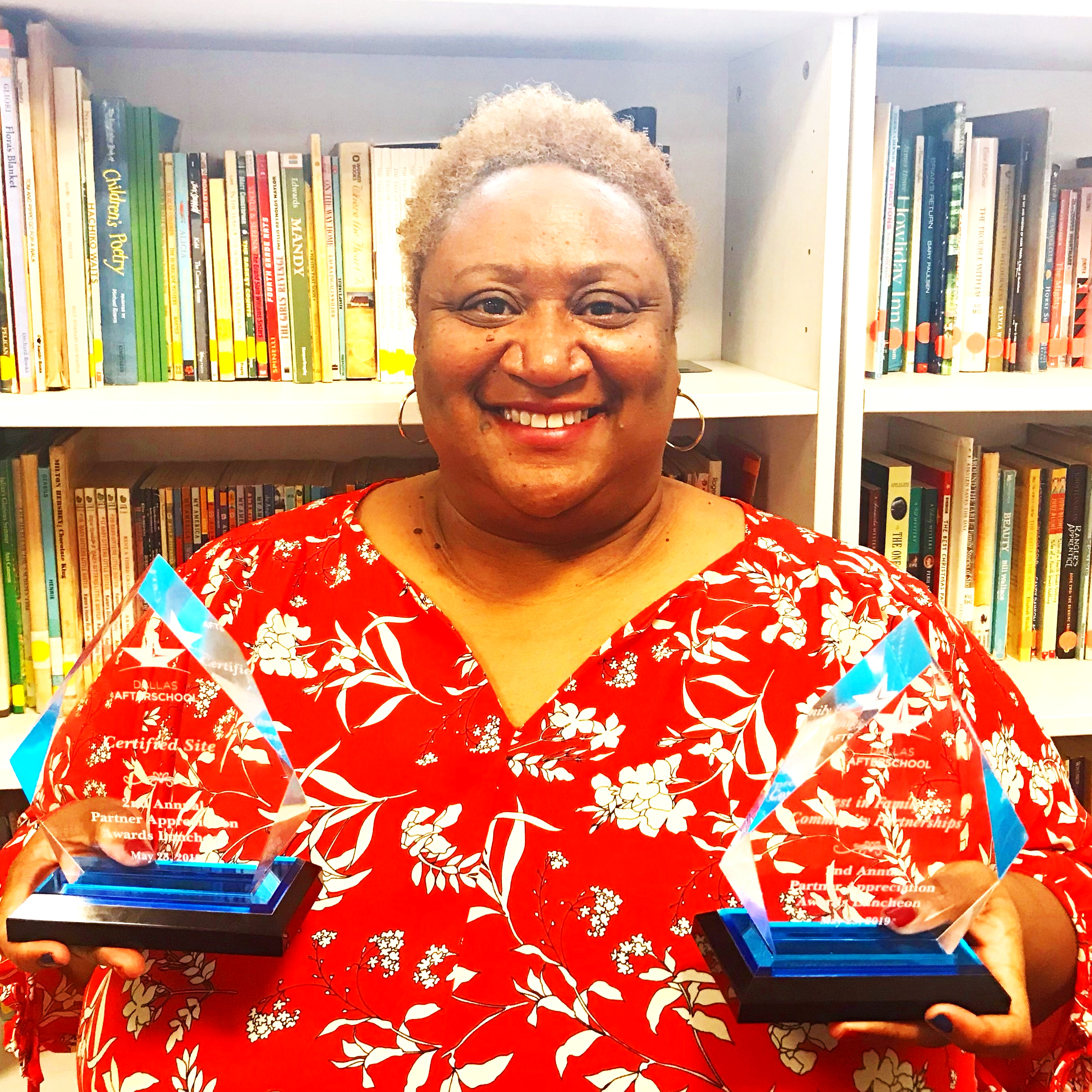 Shante McCoy-Shelley, Program Manager, with awards for Jubilee's second certified location and top Community & Family Program.