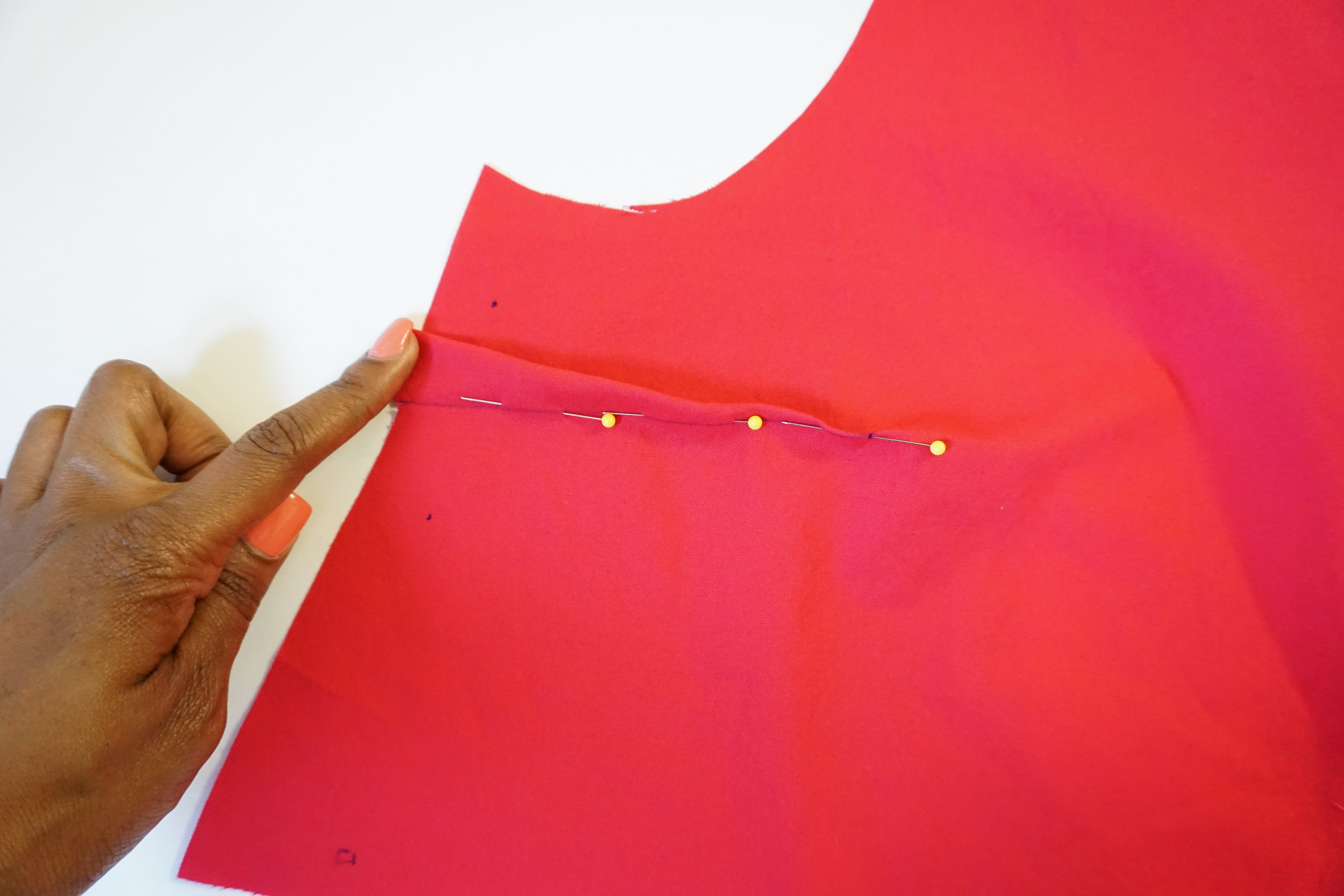 Set 2: Lets sew the front darts. Bring the dart legs together and pin in place.