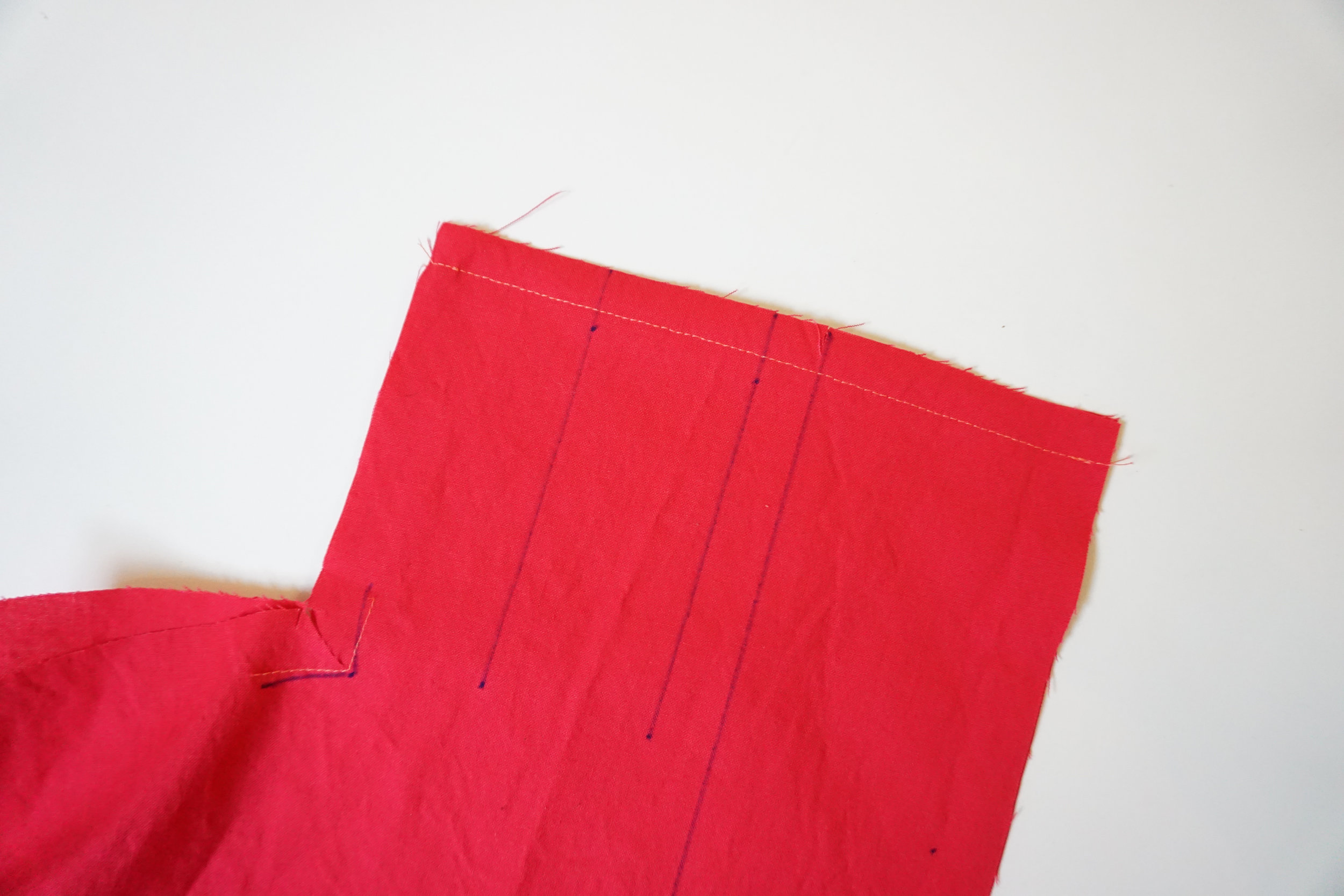 Step 3: Stitch bodice front together RIGHT sides facing at the center back.