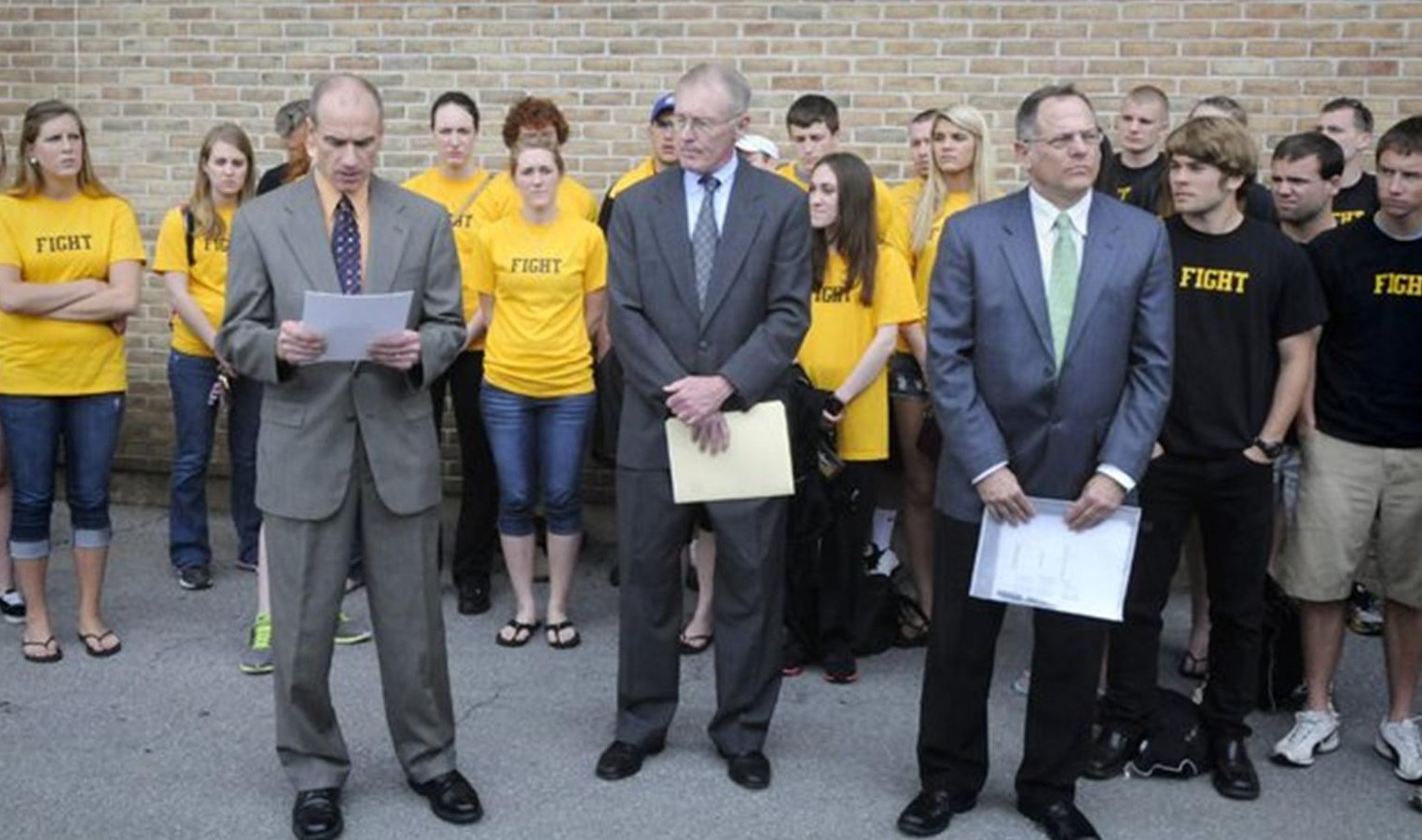(Left to right): Bob Vasile, Tom Ecker, and Glenn Stephens, CROS representatives, hold a press conference in front of Biemesderfer Stadium.