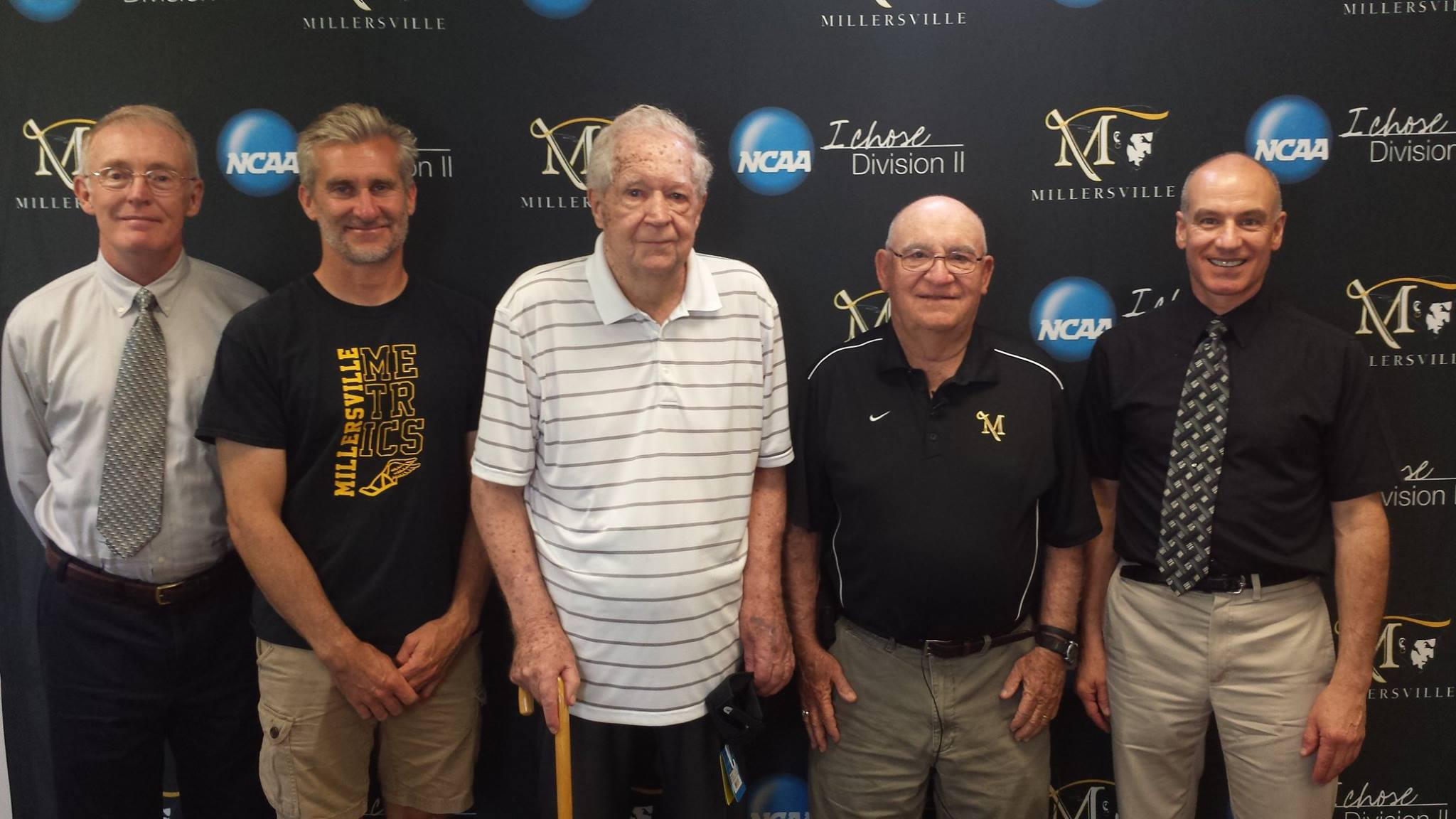 (Left to right) Tom Ecker (interviewer, All-American, and former MU runner), Andy Young (current coach), Art Hulme (founder and former coach of the cross country program and first track & field coach of the modern era), Cy Fritz (former MU cross country and track & field coach and MU's most successful coach of any sport), and Bob Vasile (interviewer and former MU runner)
