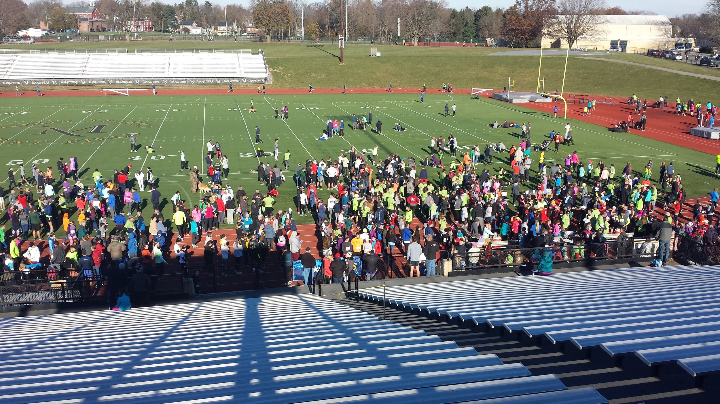 Runners and supporters at the finish area of the Turkey Trot 5K run