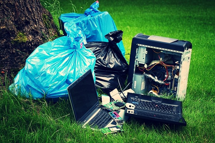 Trash and electronic waste thrown out in a forest.