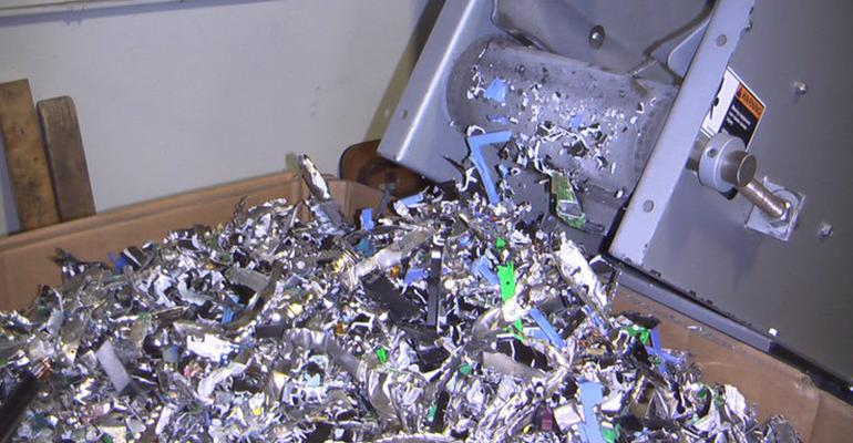 E-Waste materials after they have gone through a shredder. For more information, click the image to view our recycling process.