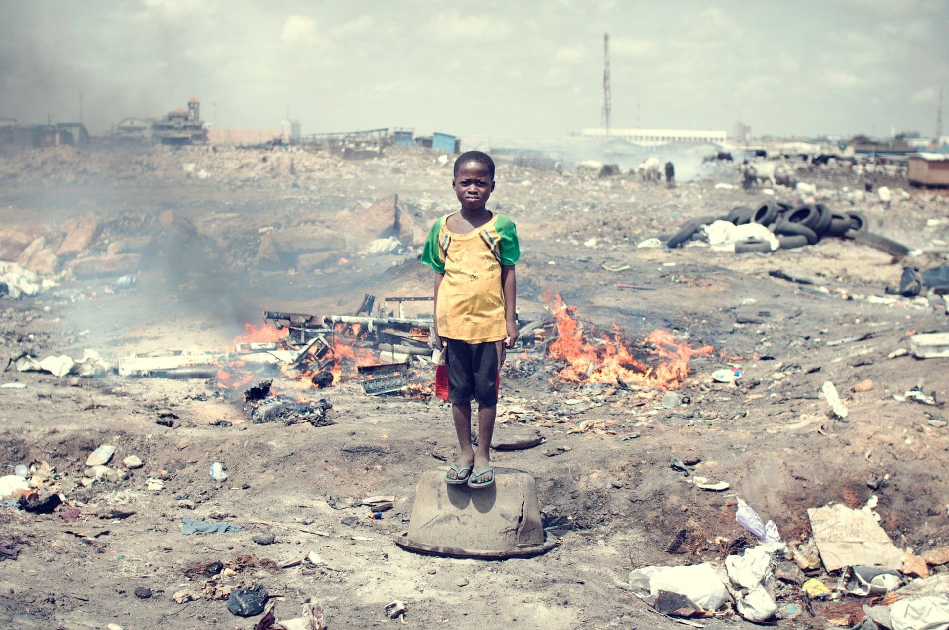 Kwabena Labobe, 10, plays on the site. His parents are not able to send him to school and forbid him to burn e-waste .