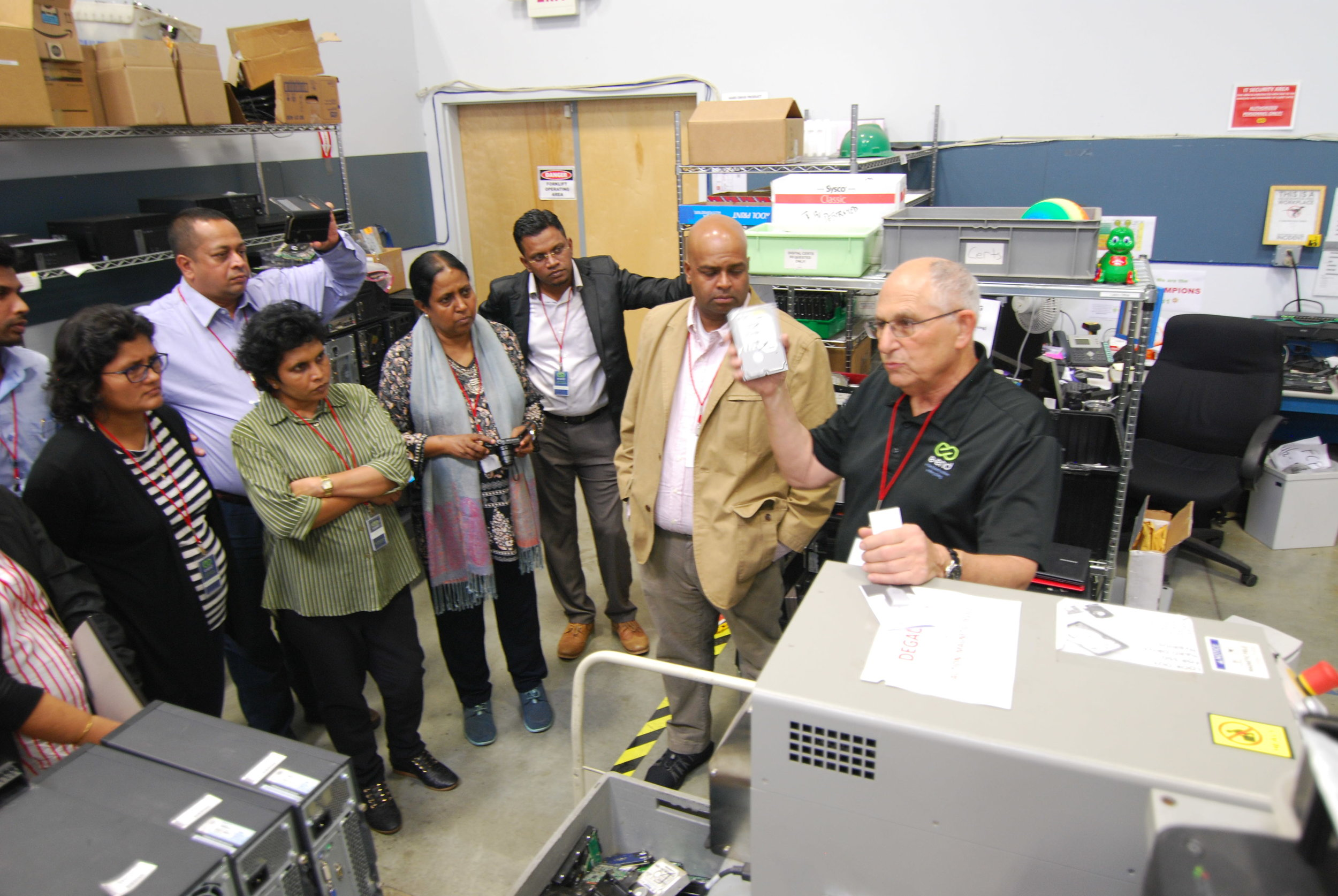 Steve Chafitz, President at e-End, demonstrating  hard drive degaussing  and quality assurance procedures.