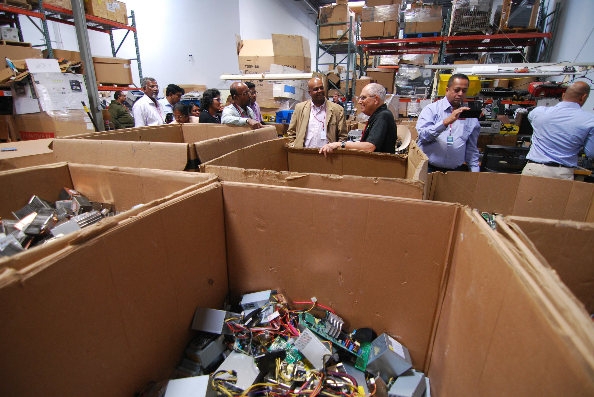 delegates with e-End in electronics warehouse.JPG