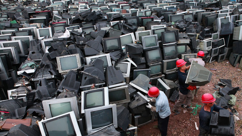 Workers in China stock piing old CRT monitors and TVs gathered from illegal importation. Photo by: LIU AIGUO - IMAGINECHINA
