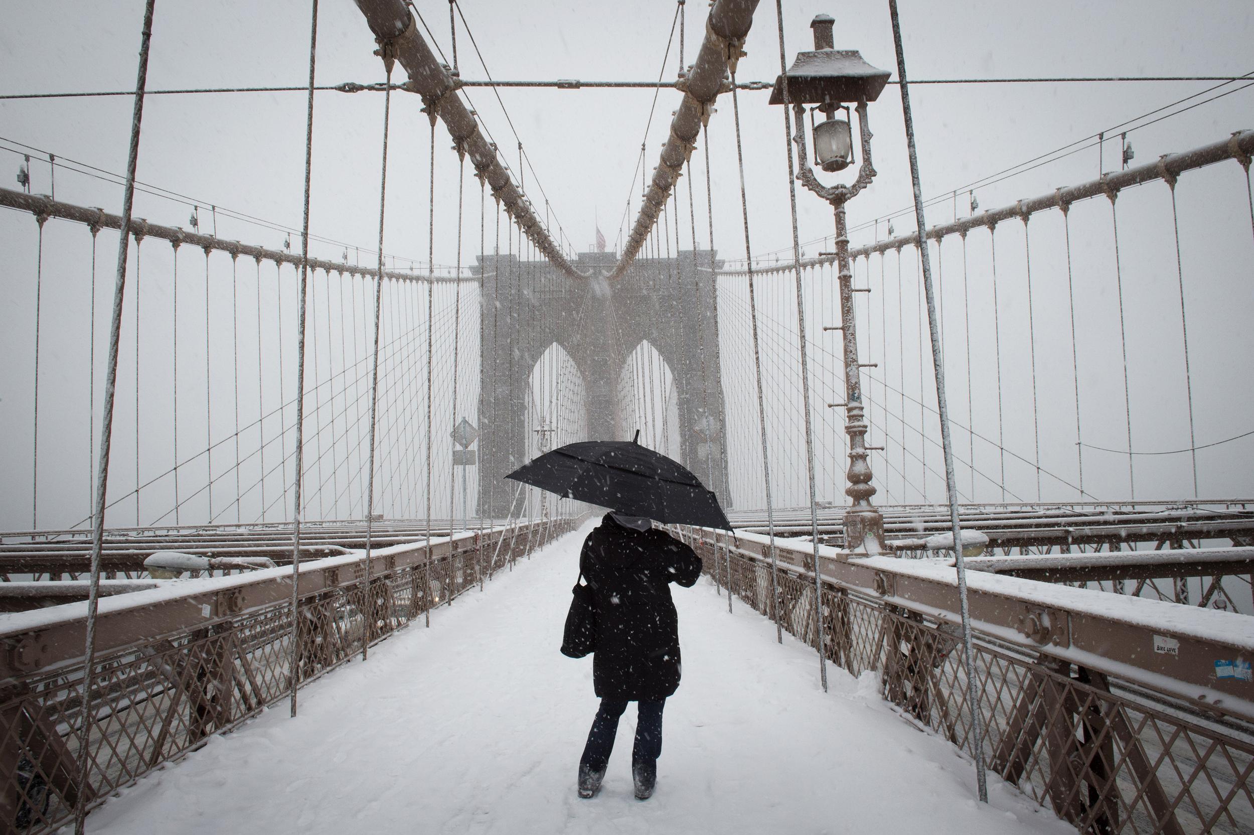A pedestrian on The Brooklyn Bridge as a snowstorm hits the Metropolitan area, Thursday, March 5, 2015.