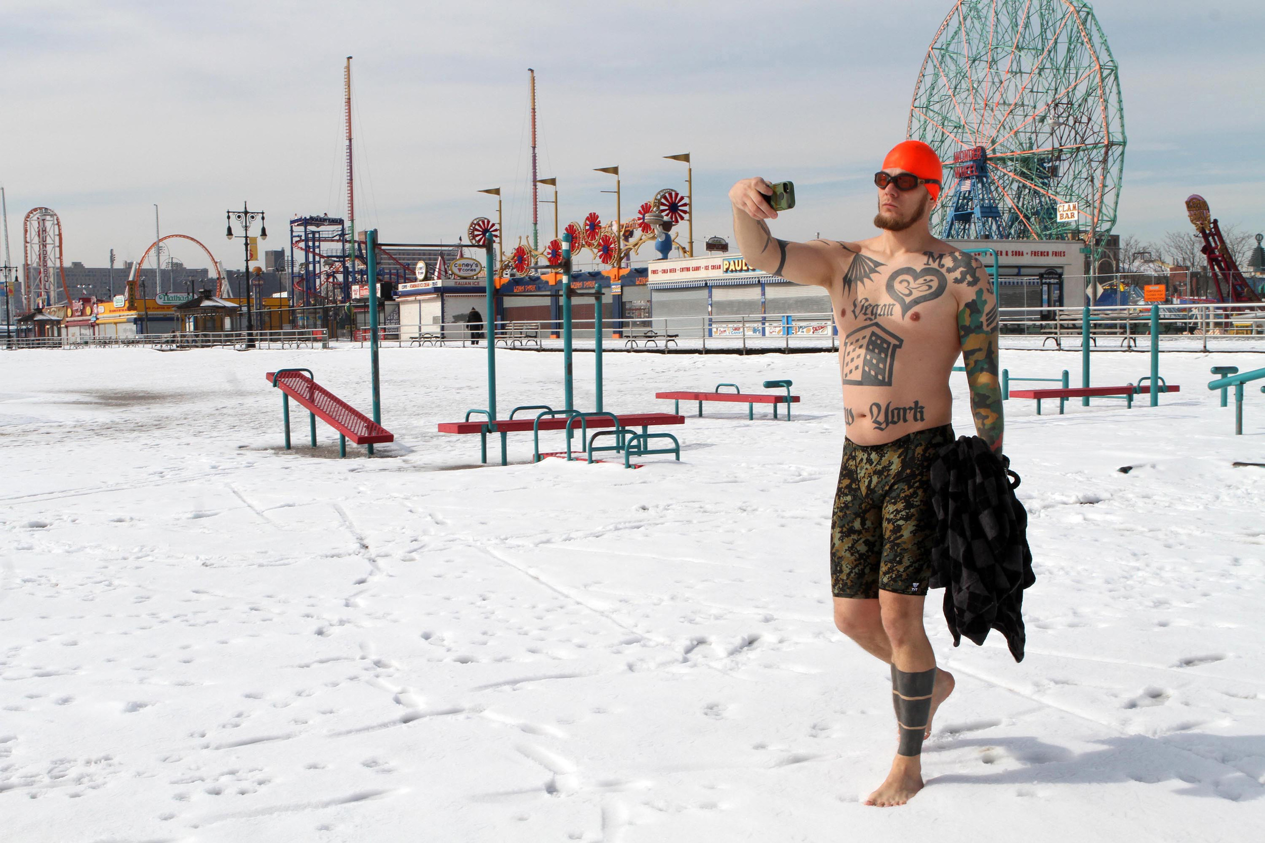 Coney Island Polar bear club goes out for their weekly swim. Member of poplar bear club takes a selfie before he jumps into the frigid water.