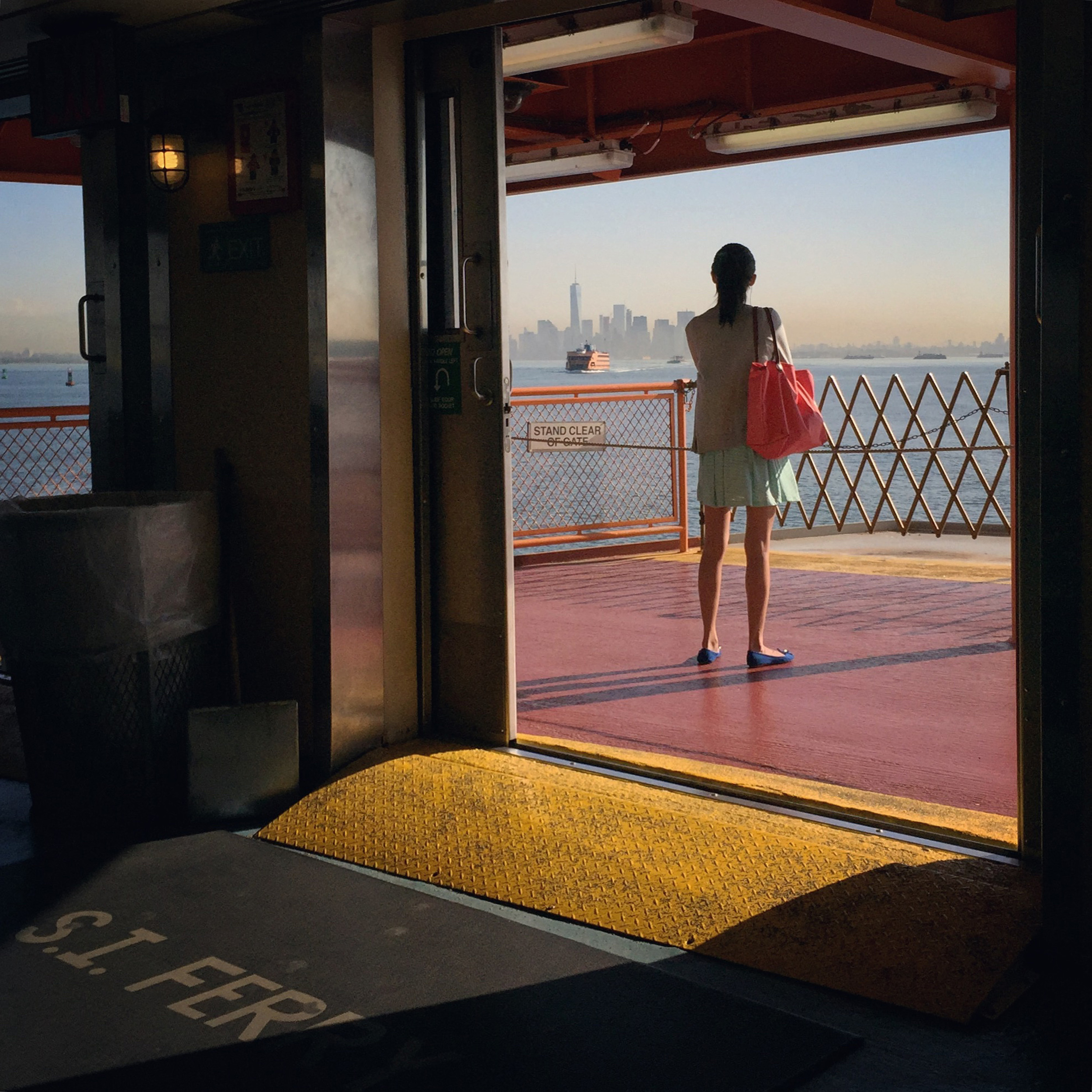A solitary passenger enjoys the view from the Staten Island Ferry during the morning commute Friday, Aug. 14, 2015, in New York.
