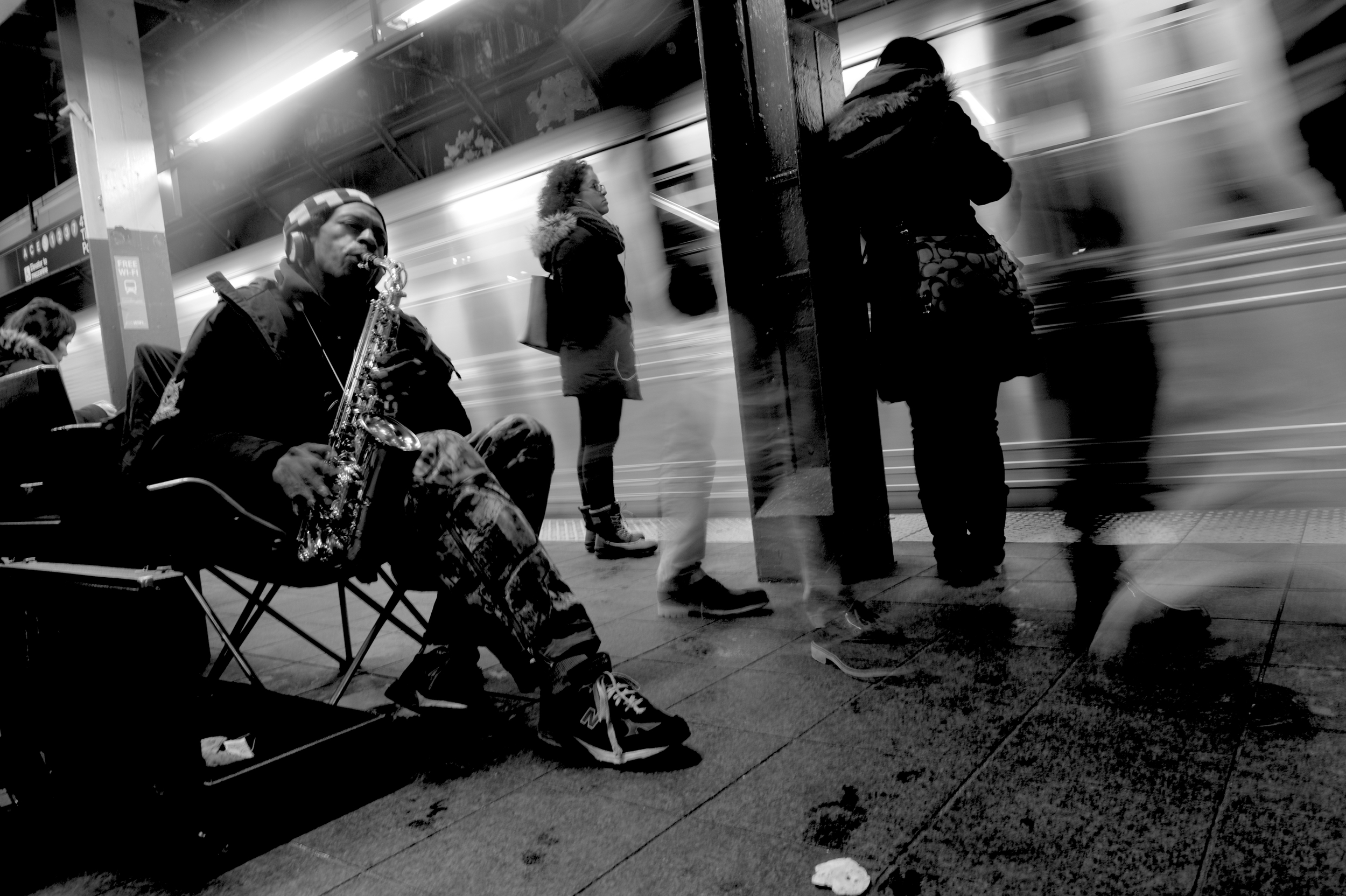 Straphangers are treated to music from a street musician inside the train station at Times Square Station in Manhattan.3-6-15