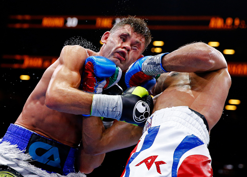 NEW YORK, NY - MAY 29:  Amir Khan punches Chris Algieri during their Welterweight bout at Barclays Center of Brooklyn on May 29, 2015 in New York City.