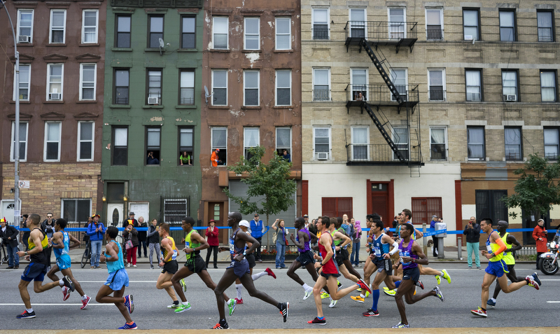 Leading runners move along 4th Ave in the Brooklyn borough of New York during the New York City Marathon Sunday, Nov. 1, 2015.