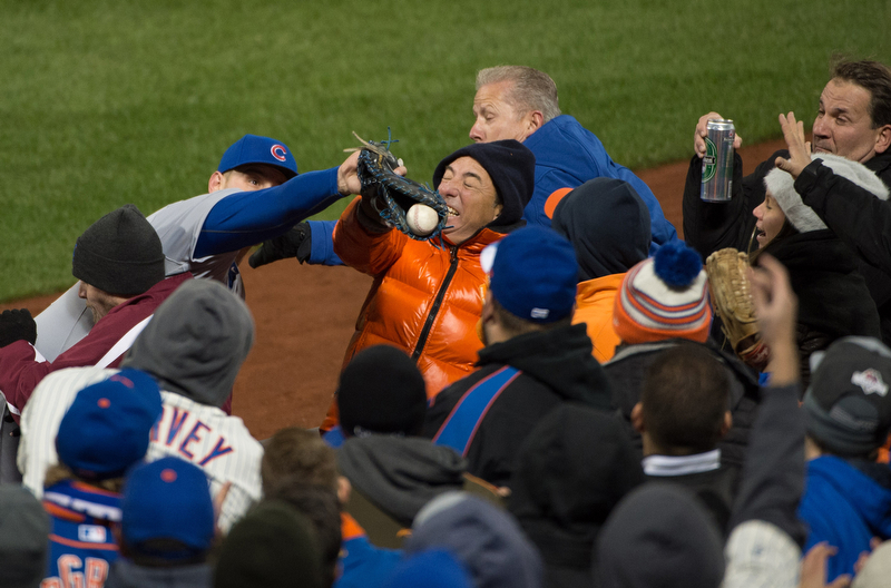 Chicago Cubs first baseman Anthony Rizzo (44) makes the catch off a foul ball by New York Mets center fielder Yoenis Cespedes (52) in the 6th inning of Game 1 of baseball's National League Championship Series at Citi Field, Saturday, Oct. 17, 2015.