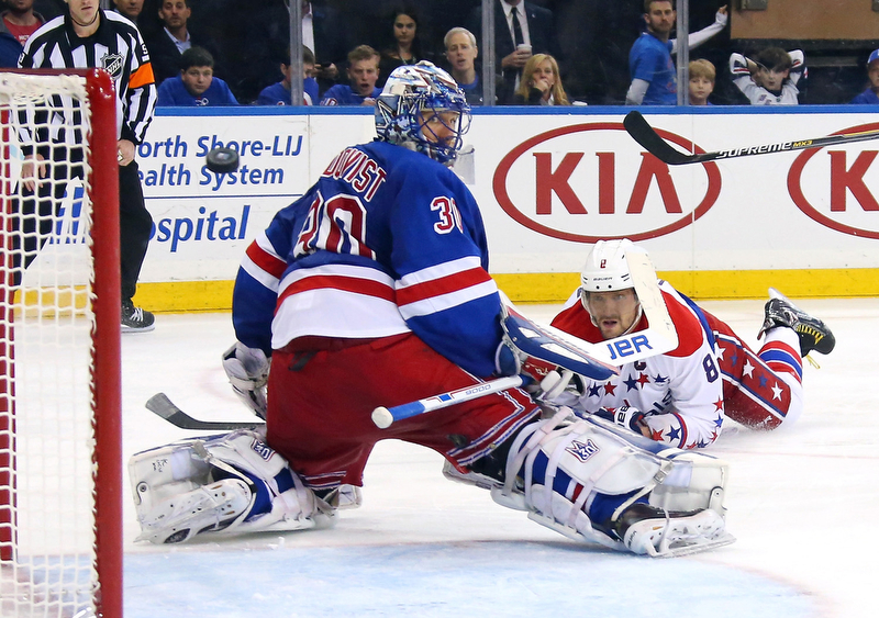 Alex Ovechkin of the Washington Capitals dives and scores a third period goal against Henrik Lundqvist of the New York Rangers in Game Two of the Eastern Conference Semifinals during the 2015 NHL Stanley Cup Playoffs at Madison Square Garden on May 2, 2015 in New York City.