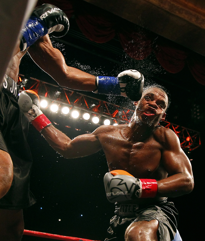 MASHANTUCKET, CT - AUGUST 16: Roy Jones Jr., left, lands a left punch to the face of Eric Watkins during their bout at Foxwoods Resort Casino on August 16, 2015 in Mashantucket, Connecticut. Jones won by a knockout in the sixth round.