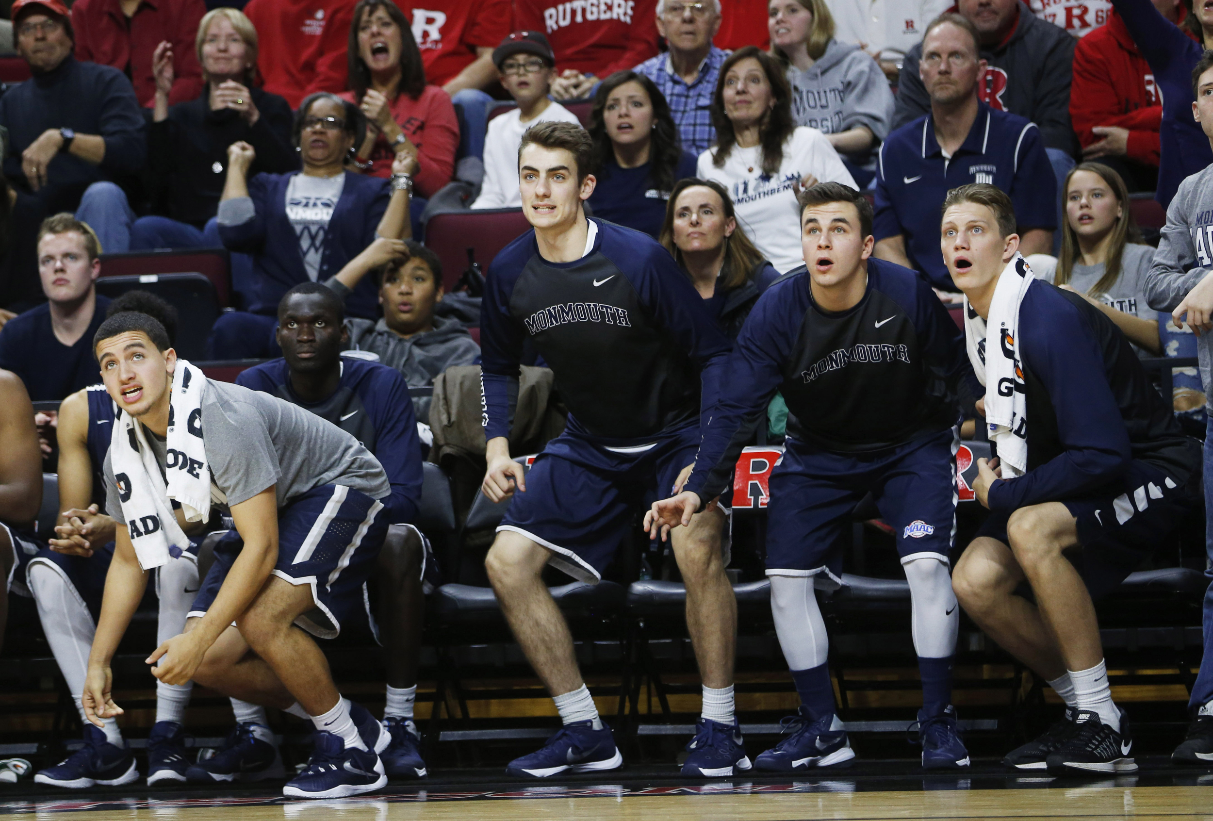 The Monmouth University bench waits to see if the shot drops as they go through a range of emotions as Monmouth defeated Rutgers 73-67 in the Rutgers versus Monmouth University mens basketball game at the RAC in Piscataway 12/20/15