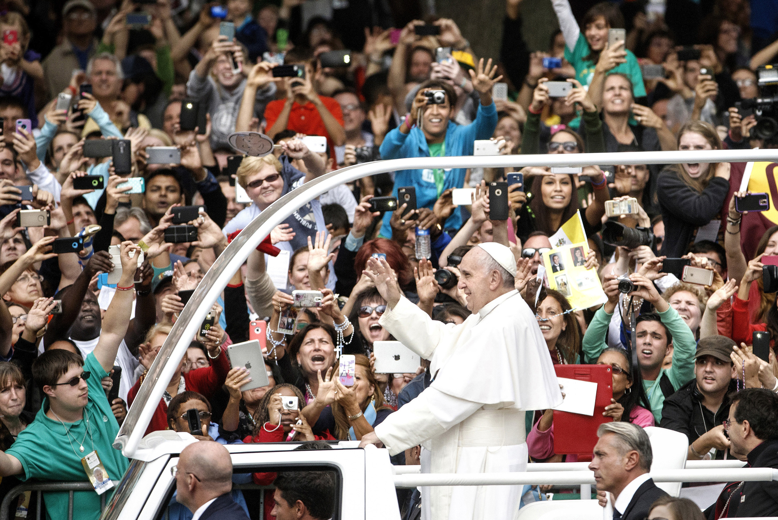 Pope Francis In Philadelphia - Pope Francis rides in the Popemobile down Benjamin Franklin Parkway at the start of Mass.  Pope Francis celebrates the closing Mass for the World Meeting of Families 2015 held outside the Philadelphia Art Museum.  Sunday September 27, 2015. Philadelphia, PA, USA