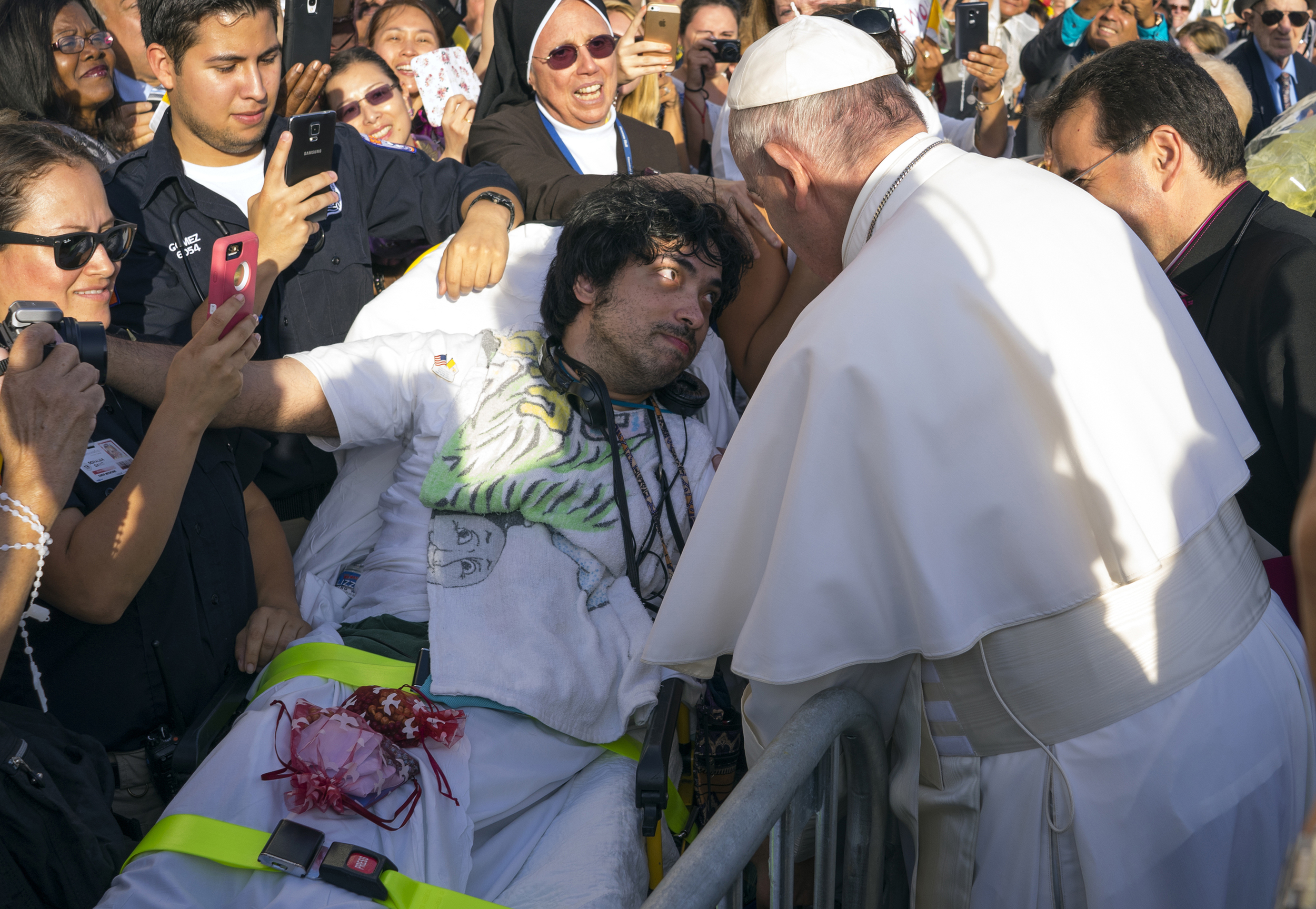Pope Francis engages well wishes including Gerard Gubatan of Brooklyn, center left, after arriving at John F. Kennedy International Airport Thursday, Sept. 24, 2015, in New York. The pope is on a five-day trip to the USA, which includes stops in Washington DC, New York and Philadelphia, after a three-day stay in Cuba.