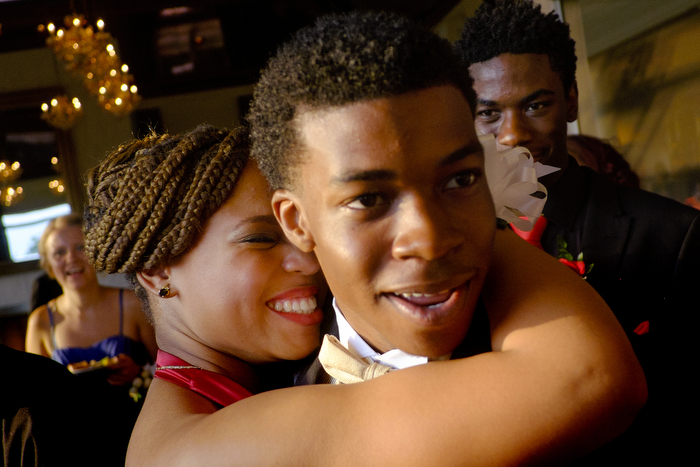 Big Hug - A girls gives her date a big hug during the Columbia High School prom held at the Westmount Country Club with DJ A-Plus providing the music.  Monday June 22, 2015. Woodland Park, NJ, USA