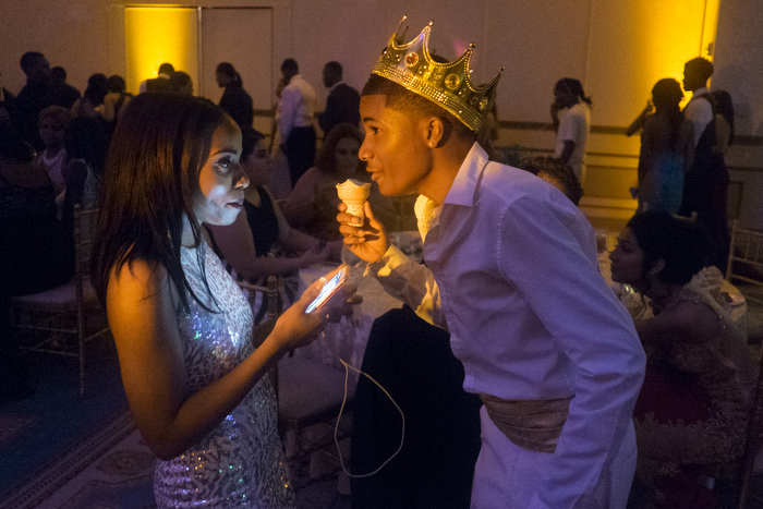 King And Ice Cream - After the desert was given out, the Prom King talks to his date at the Arts High School prom at The Grove in Cedar Grove with DJ Manchild playing the music.  Wednesday June 17, 2015. Cedar Grove, NJ, USA