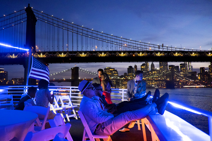 Blue View Of NY - Teenagers relax on the top deck during the Lakewood High School Prom held on the Aqua Azul boat, sailing around the Hudson and East Rivers and New York Harbor.  Sunday June 7, 2015. Weehawken, NJ, USA