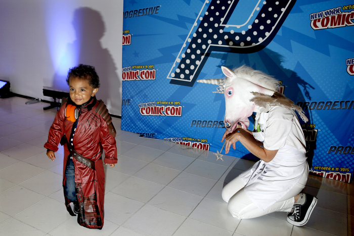 Kid And The Unicorn - Fans from all around attended the 4th and last day of New York Comic-Con 2015 which is being held at the Jacob Javits Center. Many dress as their favorite fantasy character during the event. Sunday.  Sunday October 11, 2015. New York, NY, USA
