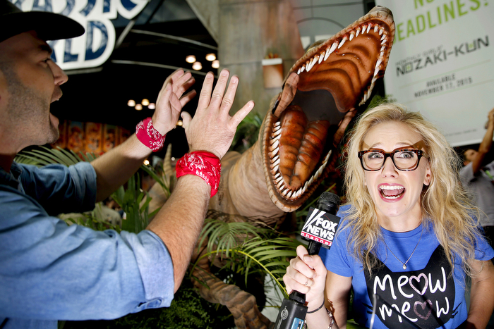 When Dinosaurs Attack - Fox News reporter Katherine Timpf reacts to a Velociraptor during her interview about the release of the DVD of the movie Jurassic World. Thursday October 8, 2015. New York, NY, USA