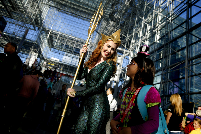Looking Up To A Queen - Saraphina Wall, of East Harlem, New York, dressed as Queen Mera from Aquaman, talks to a young fan. Fans from all around attended the 4th and last day of New York Comic-Con 2015 which is being held at the Jacob Javits Center. Sunday October 11, 2015. New York, NY, USA