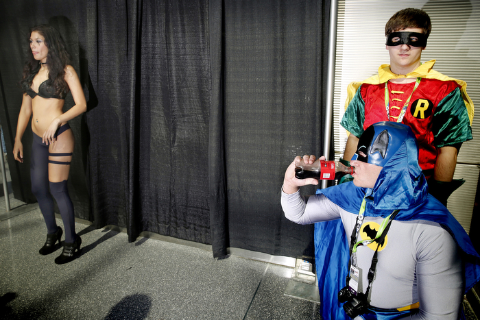 Superhero ThirstA pair of comic fans dressed as the super heroes Batman and Robin wait outside an exhibit hall during the 2015 NYC Comic Con. Hundreds of vendors sell merchandise and there are numerous panel discussions going throughout the day for fans. Friday October 9, 2015. New York, NY, USA