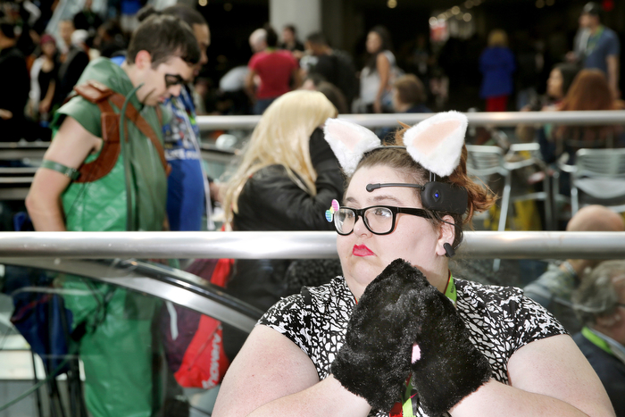 Jennifer The Cat - Dressed as a cat, Jennifer Runge, of Levittown, NY, relaxes during lunch. Fans from all around attended the 2nd day of New York Comic-Con 2015 which is being held at the Jacob Javits Center.  Friday October 9, 2015. New York, NY, USA