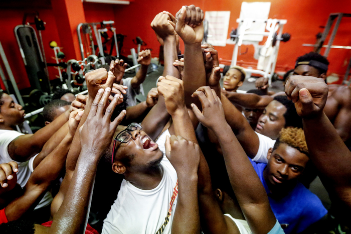 Team - Weequahic linebacker Nazir Heyward, center, shouts out team after a workout with his teammates in their weight room. This preseason, high school football teams across NJ are preparing for the season.  Wednesday August 26, 2015. Newark, NJ, USA