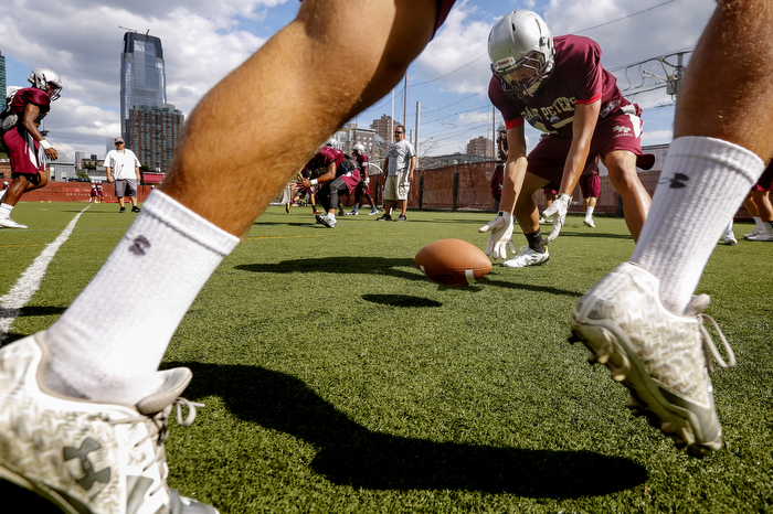 Fumble Drill - Members of the St. Peter's Prep football team practice keeping a lose ball caused by a fumble in front of them during practice.  Thursday August 27, 2015. Jersey City, NJ, USA
