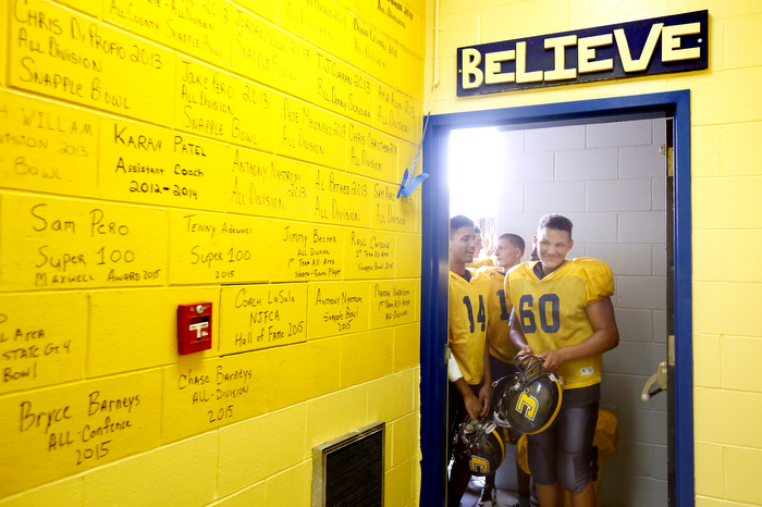 Believe - Colonia underclassman wait at the door to enter their newly renovated locker room as the upperclassmen pick out their lockers first.  Tuesday September 1, 2015. Colonia, NJ, USA