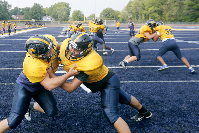 Hitting Drills - Members of the Colonia High School football team work on their blocking skills during practice.  Tuesday September 1, 2015. Colonia, NJ, USA