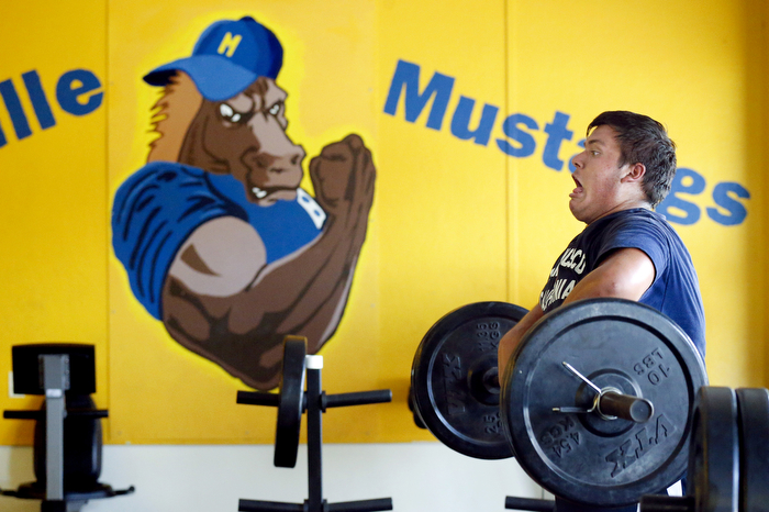 Heavy Lifting - Manville senior 345 lbs. lineman Michael Adams, performs a power clean lift during training in the schools weight room. This preseason, high school football teams across NJ are preparing for the season.   Monday August 31, 2015. Manville, NJ, USA