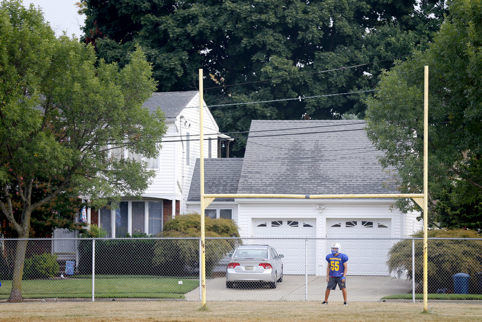 Field Goal Retriever - Manville football player Giancarlo Rojas stands underneath the goal posts so he can retrieve the ball as they practice field goals.  Monday August 31, 2015. Manville, NJ, USA