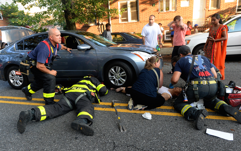Exhibit Award Todd Maisel /NY Daily News - DESPERATE MOMENTS An elderly man is pinned under the wheel of an auto after an alleged drunk driver, standing with hands on his head, struck him while crossing Avenue T in Sheepshead Bay Brooklyn August 6, 2016.